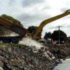 A contractor dumps rock on the Marine Parade seawall at Oamaru Harbour yesterday. Photo by Gerard...