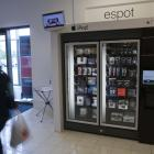 A customer walks past an e-Spot at the Macy's store in Town Centre Plaza in Leawood, Kansas. The...