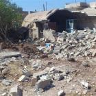 A damaged building is seen after a Syrian Air Force fighter jet fired missiles at al-Zafaranah...