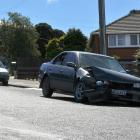 A damaged car, which had a pregnant woman among its occupants,  is parked in Saunders St after...