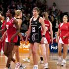 A dejected Irene van Dyk (centre) makes her way to the sideline after the Silver Ferns were upset...