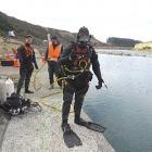 A diver prepares to enter the Rangitata Diversion Race to clear debris. Photos by John Keast.