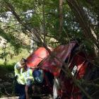A driver is removed from a car that plunged over 50 metres into Lee Stream on Thursday morning....