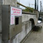 A fisherman is not deterred by the absence of emergency lifebuoys on Customhouse Quay yesterday....