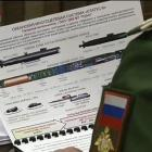 A  general studying a poster of a new weapon ''accidentally'' filmed by Russian state television.