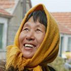 A happy Chinese woman, Shandong Province, China. File photo by NZPA.