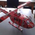 A helicopter made from drink containers.
