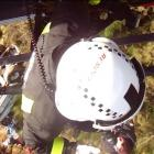 A Helicopters Otago crew member winches a Christchurch man to safety after the 4WD vehicle he and...