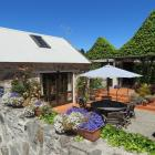 A historic Queenstown building remains in New Zealand ownership after an auction on Saturday....