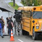 A Hollywood film crew shoots a scene from Pete's Dragon on a yellow school bus in Tapanui...