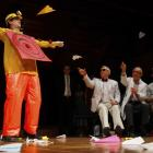 A human target is hit with paper airplanes by members of the audience and keynote speaker Robert...