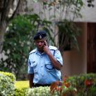 A Kenyan police officer leaves the residence of Venezuela's slain charge d'affaires Olga Fonseca...