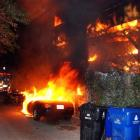 A Los Angeles Fire Department engine arrives at a fire started by an arsonist in the Laurel...