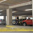 A man is taken into custody by police in a car park near central Dunedin's Work and Income New...