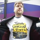A man shows off his T-shirt as he takes part in a campaign organized by activists of pro-Kremlin...