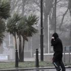 A man struggles against strong winds next to the promenade in Largs in west Scotland. REUTERS...