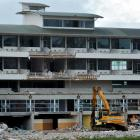 A mechanical excavator stands beneath  Carisbrook's terrace hospitality complex as demolition of...