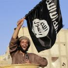 A militant Islamist fighter cheers as he takes part in a military parade in northern Syria. The...