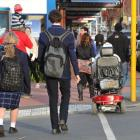 A mobility scooter crosses Factory Rd in Mosgiel yesterday. Photo by Gerard O'Brien.