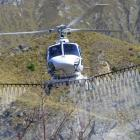 A Nokomai Helicopters aircraft uses American drift reduction nozzles on behalf of Doc Wakatipu on...
