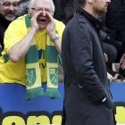 A Norwich City fan shouts at Chelsea's manager Andre Villas-Boas during their Premier League...
