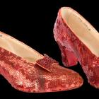A pair of ruby slippers believed to have been worn by Judy Garland in the 1939 classic film 'The...