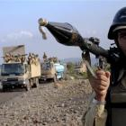A Pakistani paramilitary soldier secures an area as other troops move toward a forward base...