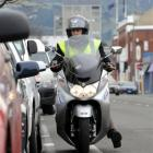 A parking officer on patrol in Dunedin. The city council yesterday backed away from its parking...
