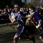 A player from Middlebury College rushes past a player from Emerson College in an Intercollegiate...