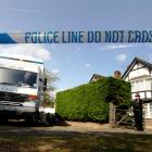A police officer stands by a cordon close to the home of Saad al-Hilli and his family in Claygate...