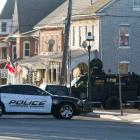 A police vehicle is seen near a home in in Pennsburg, Pennsylvania, where a suspect in six...