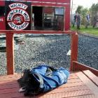 A police vest remains on the deck at the back of a house, as police work to remove a section of...
