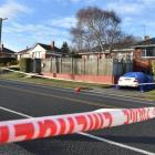 A policeman stands at a cordon around a Waldronville property during a homicide investigation on...