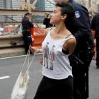 A protester reacts as she is arrested on the Brooklyn Bridge during an Occupy Wall Street march...