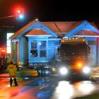 The cottage is shifted along Andersons Bay Rd about 4am yesterday. Photo Stephen Jaquiery