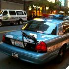 A rifle is left unattended on a patrol car outside a busy downtown area in Seattle. (AP Photo...