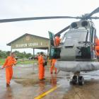A search and rescue squad from the Indonesian Airforce prepare to depart to take part in the...
