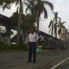 A security guard stands near a damaged Chinese-owned shoe factory in Vietnam's southern Binh...