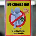 A shop displays a sign indicating it does not sell synthetic cannabis products. Photo by Peter...