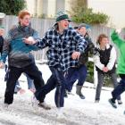 A snow attack is unleashed in Highgate, Dunedin, yesterday. Photo by Stephen Jaquiery/Craig Baxter.