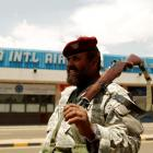A soldier stands outside Sanaa International Airport in Yemen. REUTERS/Khaled Abdullah