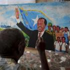 A Somali artist paints an impression of Somalia's President Hassan Sheikh Mohamud in  the Somali...