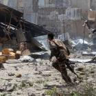 A Somali soldier runs near the scene of a deadly blast outside the law courts in Mogadishu....