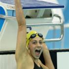 A Speedo-clad Stephanie Rice, of Australia, celebrates winning the gold after the final of the...