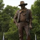 A statue of John Wayne, donated by his children, stands on the site in Winterset, Iowa, where a...
