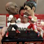 A statuette featuring miniature figurines of boxers Floyd Mayweather jun (left), of the United...