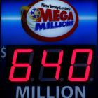 A storefront sign displays the jackpot total of today's Mega Millions lottery in Hoboken, New...