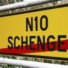 A street sign marks the end of the small Luxembourg village of Schengen last week. The Schengen...