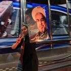 A supporter of moderate cleric Hassan Rohani celebrates his victory in Iran's presidential...