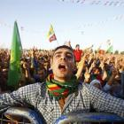 A supporter of the Pro Kurdish Peoples' Democratic Party  cheers during a gathering last week in...